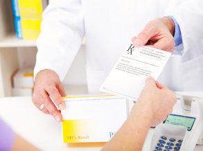 pharmacist giving medical prescription to the customer