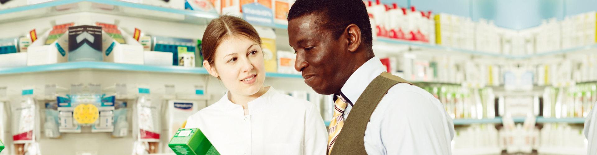 pharmacist helping a customer